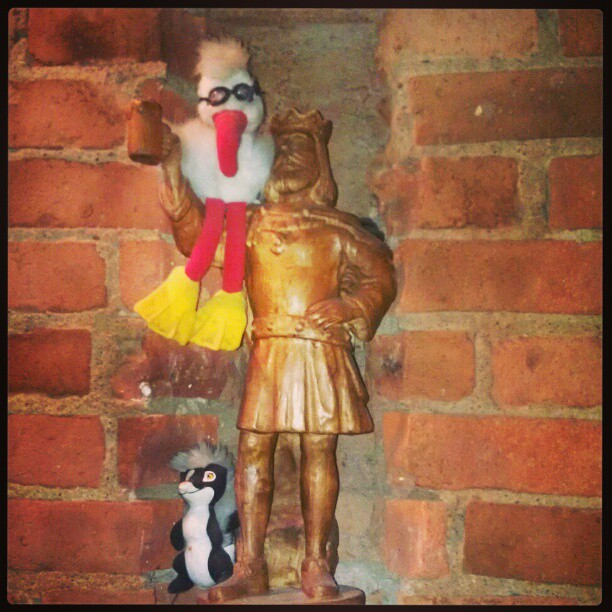 The King of Beer & his little birdi always watching over Glight's Bar. - from Instagram