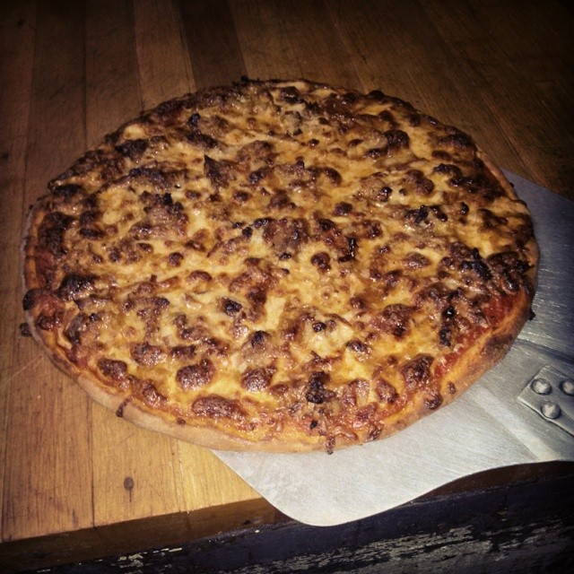 Pulled Pork & Chicken Pizza topped with Both jack & mozzarella cheese finished with house smoked bacon & Bigdog Porter BBQ sauce. Sooooo Good Enjoy. - from Instagram