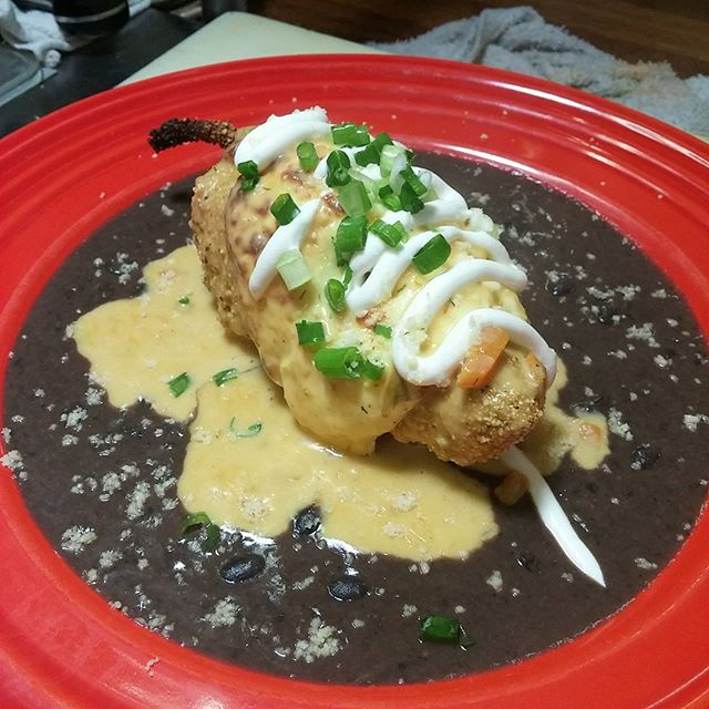 Chile Relleno are stuffed with corn, chicken, audouille, chorizo, green chili & rice. Placed on a black bean sauce. Topped with queso fresco and a wonderful beer cheese sauce.Real nice!!! #chilierelleno #greenchile #blackbean #quesofresco #southorange #brewpub #poblano - from Instagram
